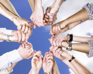 people-working-together-holding-hands-clouds-sky-prayer-arms-circle